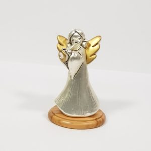 Silver-plated angel playing trumpet, figurine.